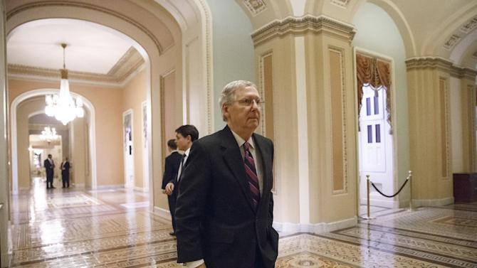 Senate Minority Leader Mitch McConnell, R-Ky., walks to the chamber for the final votes on the bipartisan budget deal designed to keep Congress from lurching from one fiscal crisis to the next and ease the harshest effects of the automatic budget cuts known as the sequester, at the Capitol in Washington, Wednesday, Dec. 18, 2013. (AP Photo/J. Scott Applewhite)