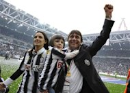 Juventus' coach Conte celebrates after winning their 28th Italian Serie A title at the end of their match against Atalanta at the Juventus stadium in Turin