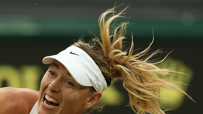 Russia's Maria Sharapova serves to US player Alison Riske during their women's singles third round match on day six of the 2014 Wimbledon Championships at The All England Tennis Club in Wimbledon, southwest London, on June 28, 2014