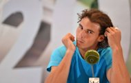 Spain&#39;s Rafael Nadal gives a press conference on the eve of his first singles match at the ATP Gerry Weber Open in the western German city of Halle on June 13. Paris police have recovered a 300,000-euro ($375,000) watch stolen from Nadal at the hotel where he stayed during the French Open and arrested a hotel employee, a police source said Wednesday