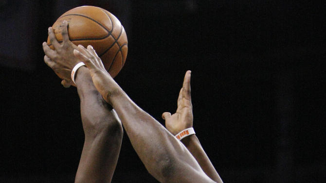 Oklahoma City Thunder guard Reggie Jackson (15) shoots over Memphis Grizzlies Zach Randolph during the second quarter of Game 1 of their Western Conference Semifinals NBA basketball playoff series in Oklahoma City, Sunday, May 5, 2013.  (AP Photo/Alonzo Adams)