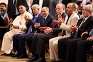 Libyan National Transitional Council chairman Mustafa Abdel Jalil (3rdL) and Libyan Prime Minister Abdel Rahim al-Kib (3rdR) applaud during the Libyan General Assembly election general results. If liberals do manage to hold sway over the assembly, Libya, unlike neighbouring Tunisia and Egypt, will buck the trend of electoral success for Islamist movements