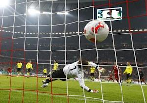 Borussia Dortmund's goalkeeper Weidenfeller receives a goal by Bayern Munich's Robben during their German soccer cup, DFB Pokal, quarter final match in Munich