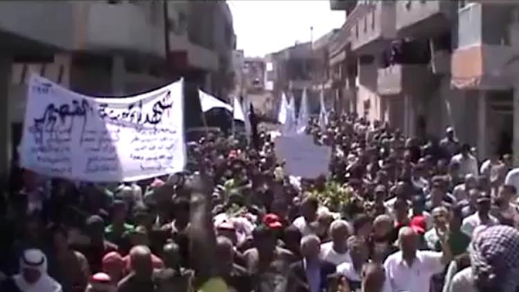 This image made from amateur video released by Shaam News Network and accessed Friday, June 1, 2012, purports to show the funeral for a Syrian worker killed near Qusair, in Homs province, Syria. Gunmen killed several workers at a state-owned fertilizer factory in a volatile central Syrian province, activists said Friday, the second execution-style shooting reported in Syria in less than a week. The shooting near the town of Qusair in Homs province occurred Thursday as the workers were on their way to their jobs in a bus that came under fire, said the Britain-based Syrian Observatory for Human Rights. (AP Photo/Shaam News Network via AP video) THE ASSOCIATED PRESS CANNOT INDEPENDENTLY VERIFY THE CONTENT, DATE, LOCATION OR AUTHENTICITY OF THIS MATERIAL