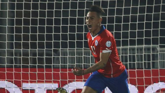 Chile's Vargas celebrates after scoring a goal past Peru's goalie Gallese during their Copa America 2015 semi-final soccer match at the National Stadium in Santiago
