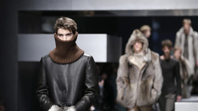 A model wears a creation for Fendi men's Fall-Winter 2013-14 collection, part of the Milan Fashion Week, unveiled in Milan, Italy, Monday, Jan. 14, 2013. (AP Photo/Antonio Calanni)