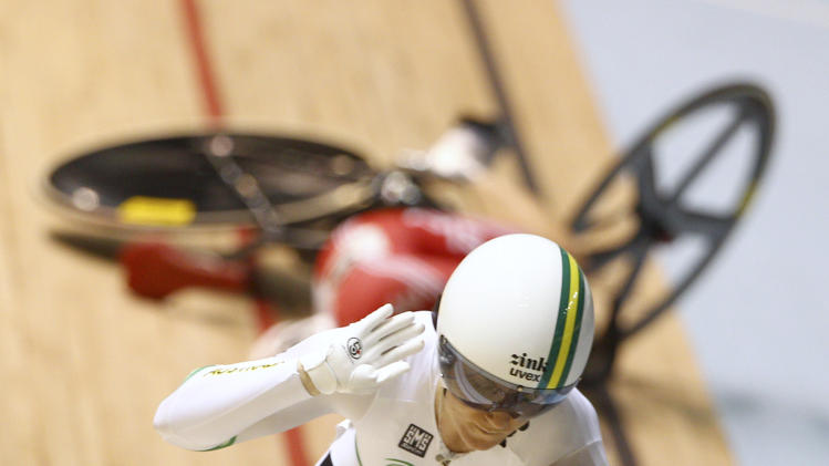 Britain's Victoria Pendleton, back, crashes during her semifinal against Australia's Anna Meares in the women's sprint at the Track Cycling World Championships in Melbourne, Australia, Friday, April 6, 2012.  (AP Photo/Rick Rycroft)