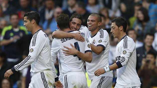 Real Madrid's Gonzalo Higuain celebrates his goal against Celta Vigo with team mates (Reuters)