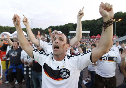 German soccer fans watch a Euro 2012 match between Germany and the Netherlands at the fan zone in Gdansk