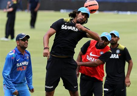 India's cricket player Ishant Sharma (2nd L) heads a soccer ball as he takes part in a training session ahead of their first One-Day International (ODI) against South Africa on Thursday, in Johann
