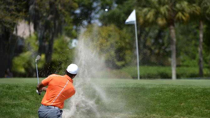 Tiger Woods hits a shot from a bunker on the fourth hole during the second round of the Arnold Palmer Invitational golf tournament, Friday, March 22, 2013, in Orlando, Fla. (AP Photo/Phelan M. Ebenhack)