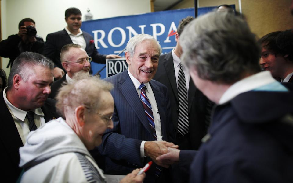Republican presidential candidate, U.S. Rep. Ron Paul, R-Texas, campaigns at the Cass County Community Center in Atlantic, Iowa, Thursday, Dec. 29, 2011. (AP Photo/Charles Dharapak)