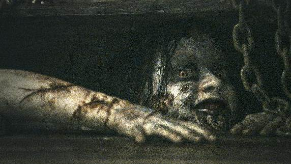 """This film image released by Sony-TriStar Pictures shows a scene from """"Evil Dead."""" (AP Photo/Sony-TriStar Pictures)"""