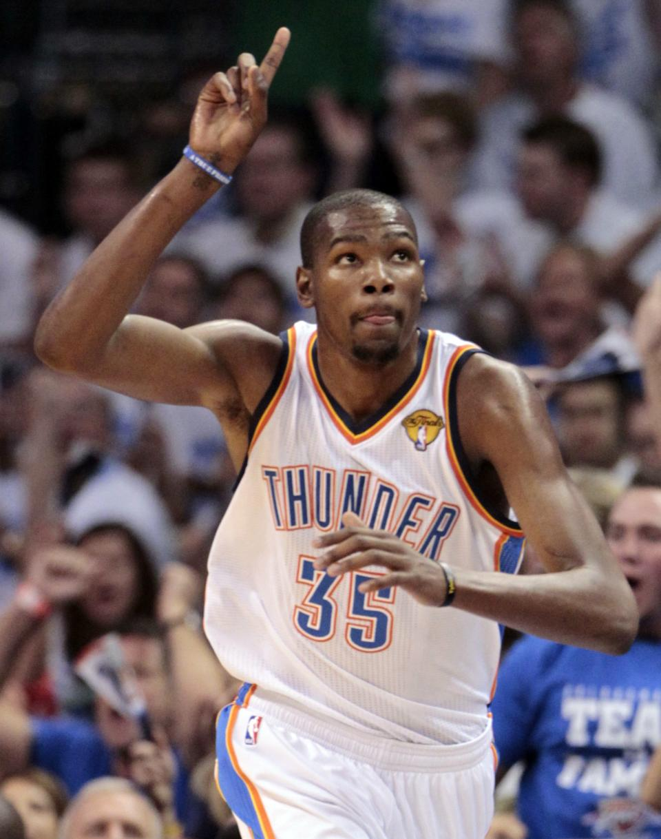 Oklahoma City Thunder small forward Kevin Durant (35) heads down court against the Miami Heat during the second half at Game 2 of the NBA finals basketball series, Thursday, June 14, 2012, in Oklahoma City. (AP Photo/Jeff Roberson)