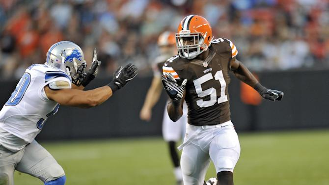 Cleveland Browns linebacker Barkevious Mingo (51) runs down on kick coverage against Detroit Lions linebacker Travis Lewis in the first quarter of a preseason NFL football game, Thursday, Aug. 15, 2013, in Cleveland. Mingo later left the game with a rib injury. (AP Photo/David Richard)