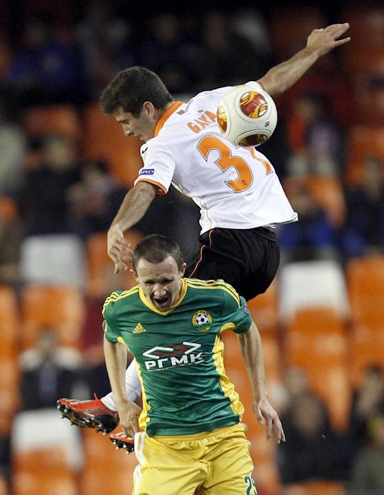 Kuban Krasnodar's Aleksei Kozlov, bottom, duels for the ball with Valencia's Jose Gaya, top,  during their  Europa  League Group A soccer match at the Mestalla stadium in Valencia, Spain, Thur