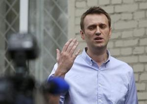Opposition leader Alexei Navalny talks to media after leaving justice court building in Moscow