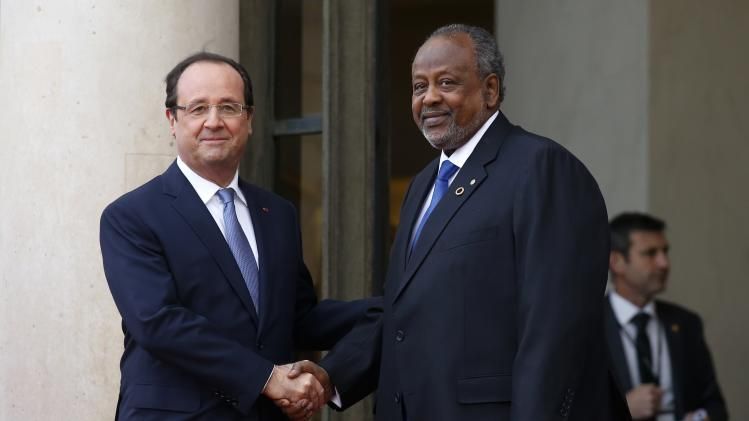 France's President Hollande greets Djibouti's President Ismail Omar Guelleh in the courtyard of the Elysee Palace at the start of the Elysee Summit for Peace and Security in Africa, in Paris