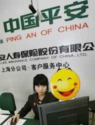 An employee of Ping An Insurance is seen working at the Shanghai Stock Exchange in 2007. Relatives of China's reformist premier have amassed huge riches during his tenure, according to a report in the New York Times that came as the Communist Party strives to clean house before a pivotal handover of power