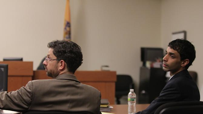 Defense attorney Philip Nettl and  Dharun Ravi listen to testimony during  Ravi's trial at the Middlesex County Courthouse in New Brunswick, Monday, March 12, 2012. Ravi, 20, is accused of using a webcam for the central crime, then using Twitter, instant messages and texts to tell friends about it. He's charged with 15 criminal counts, including bias intimidation and invasion of privacy. His roommate, Tyler Clementi, committed suicide in September 2010, just days after the alleged spying. (AP Photo/The Star-Ledger, John O'Boyle, Pool)