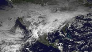 A storm system moving across the United States is pictured in this NASA handout satellite photo