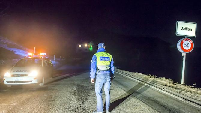 Police close off the road to Daillon after a shooting, in Switzerland, early Thursday, Jan. 3, 2013. A man shot and killed three people and wounded another two in a Swiss village, and was then arrested by officers who shot and injured him, police said Thursday. Police in the southern canton (state) of Valais said they were alerted to the shooting in the village of Daillon just before 9 p.m. (20:00GMT) Wednesday. Three of the victims died at the scene and the two injured people were taken to hospitals. A police statement early Thursday gave no detail on their injuries. (AP Photos/Keystone, Olivier Maire)