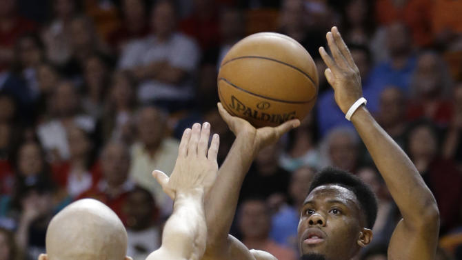 Miami Heat guard Norris Cole (30) shoots against New York Knicks guard Jason Kidd (5) during the first half of an NBA basketball game, Tuesday, April 2, 2013 in Miami. (AP Photo/Wilfredo Lee)
