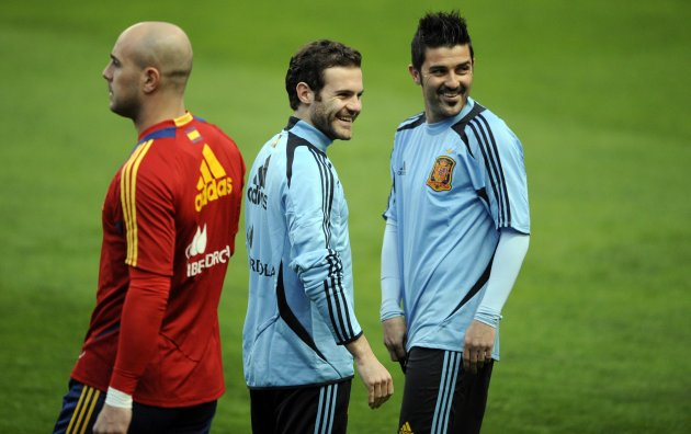 Spain's Reina, Mata and Villa attend a training session at El Molinon stadium in Gijon