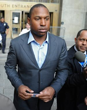 Detroit Tigers left fielder Delmon Young, left, exits Manhattan criminal court after posting bail on Friday, April 27, 2012, in New York. Police say Young got into a fight with a group of men early Friday outside the team's midtown Manhattan hotel and yelled anti-Semitic epithets. (AP Photo/Louis Lanzano)