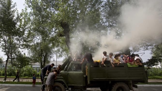 In this Aug. 11, 2012 photo, a truck, retrofitted to run on a barrel of burning wood, stops on a road in Hamhung, North Korea. (AP Photo/David Guttenfelder)