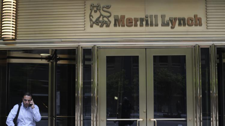 File photo of a man speaking on his mobile while standing in front of the Merrill Lynch building in New York