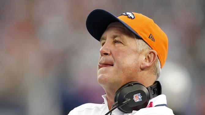 FILE - In this Oct. 6, 2013 file photo, Denver Broncos head coach John Fox watches during the first quarter of an NFL football game against the Dallas Cowboys, in Arlington, Texas. Fox needs heart surgery and will miss several weeks, team spokesman Patrick Smyth confirmed Saturday night, Nov. 2, 2013. The 58-year-old Fox will undergo aortic valve replacement surgery early next week at a hospital in Charlotte, N.C. (AP Photo/Sharon Ellman, File)