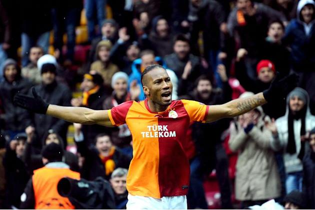 Galatasaray's Ivorian forward Didier Drogba celebrates after his team won the UEFA Champions League group B football match against Juventus at the TT Arena in Istanbul on December 11, 2013
