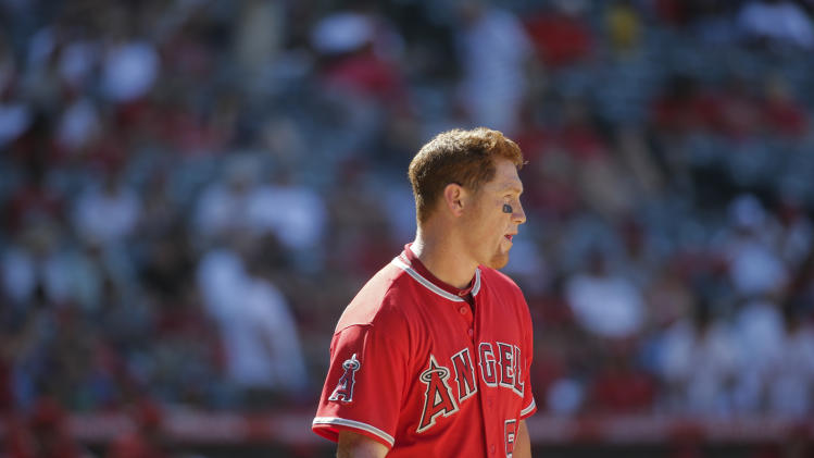 Los Angeles Angels' Kole Calhoun stands on the field after he struck out during the ninth inning of a baseball game against the Toronto Blue Jays on Wednesday, July 9, 2014, in Anaheim, Calif. (AP Photo/Jae C. Hong)