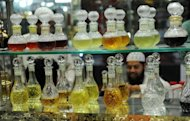 A man tests attar at a shop in New Delhi. Attar is increasingly shunned by India's brand-conscious consumers who have become used to foreign products since economic reforms in the 1990s opened up the country