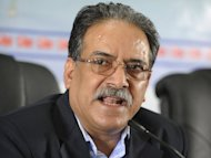 Maoist party chairman Pushpa Kamal Dahal, also known as Prachanda, addresses a 2011 press conference in Kathmandu. Prachanda has called for rival parties to join a national unity government to take the country to fresh elections and said he was open to a change of prime minister