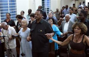 U.S. civil rights activist Jesse Jackson holds hands with believers during a religious service at the Martin Luther King Baptist congregation in Havana