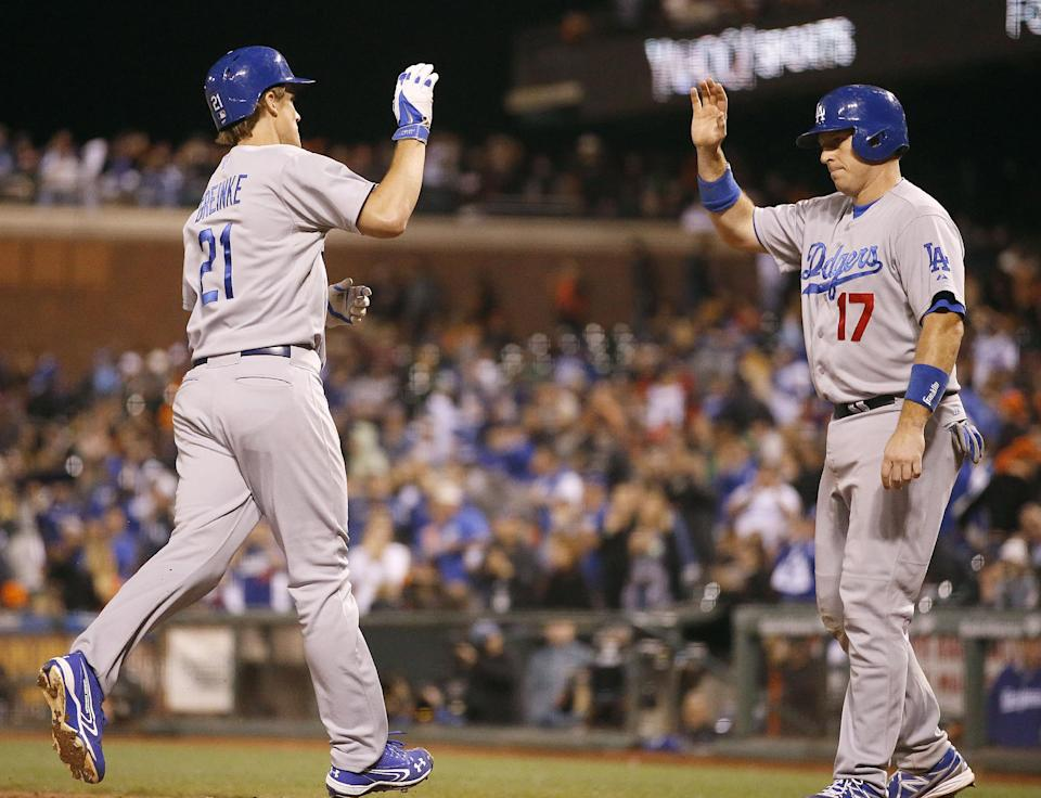 Greinke pitches, hits Dodgers past Giants