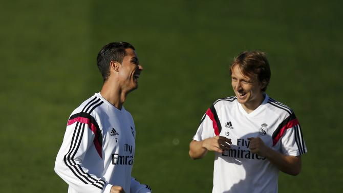 """Real Madrid's Cristiano Ronaldo and Modric laugh during their training session on the eve of their Spanish first division """"Clasico"""" soccer match against Barcelona in Madrid"""