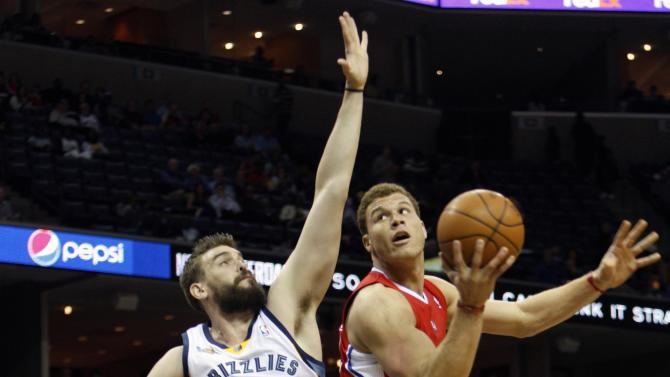 Memphis Grizzlies center Marc Gasol defends Los Angeles Clippers forward Blake Griffin (32) in the first half of an NBA basketball game Tuesday, April 5, 2011, in Memphis, Tenn.   (AP Photo/Alan Spearman)