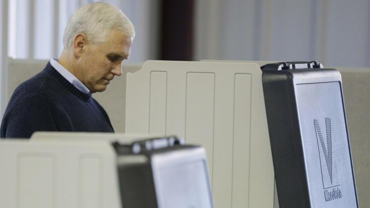 Indiana's Republican gubernatorial  candidate Mike Pence casts his vote, Tuesday, Nov. 6, 2012, in Clifford, Ind. Pence is running against Democrat John Gregg and Libertarian Rupert Boneham. (AP Photo/Darron Cummings)