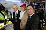 Qantas Chief Executive Alan Joyce (R) and Emirates President Tim Clark (3rd R) pose for a photo on board an Emirates aircraft, at Sydney Airport, on September 6, 2012. Australia&#39;s competition watchdog on Thursday gave its preliminary approval to a global alliance between struggling Qantas and Dubai-based Emirates, but only for five years initially