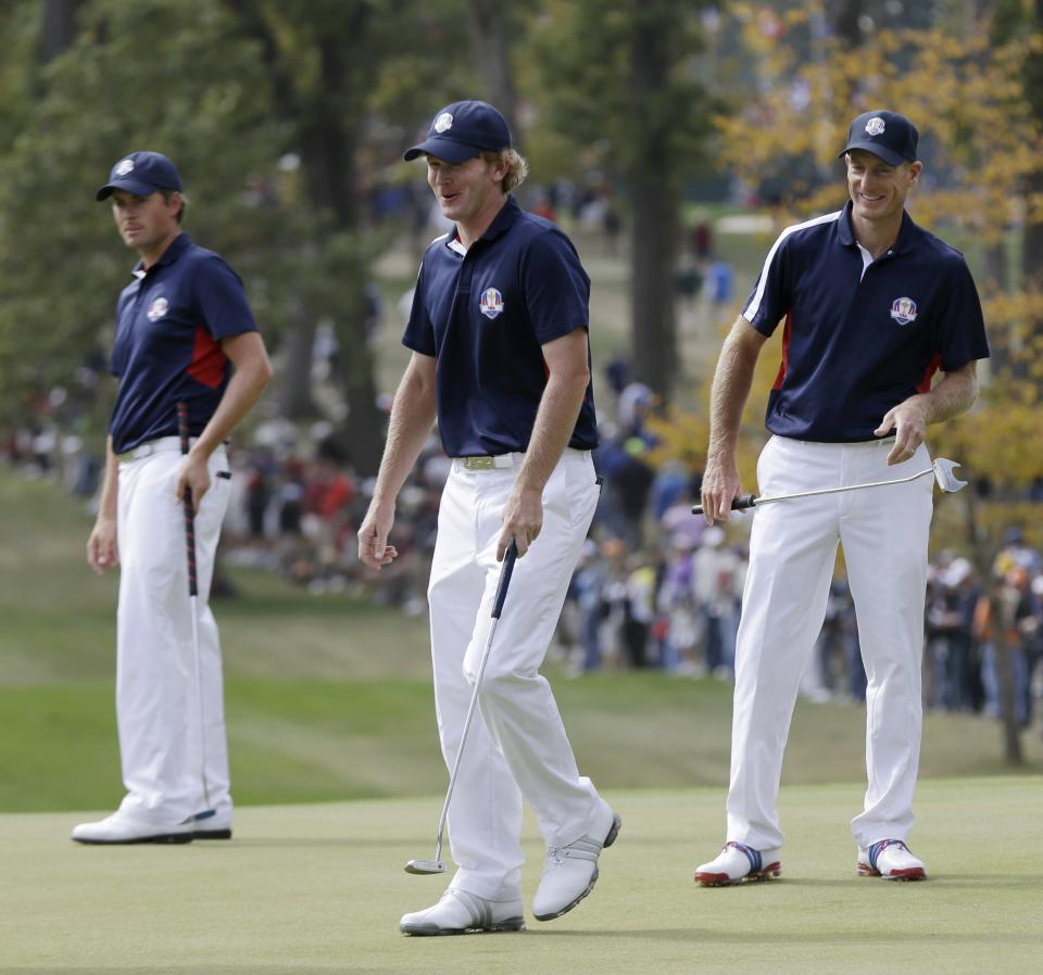 USA's Webb Simpson, left to right, Brandt Snedeker and Jim Furyk look over the green on the fourth hole during a practice round at the Ryder Cup PGA golf tournament Thursday, Sept. 27, 2012, at the Medinah Country Club in Medinah, Ill. (AP Photo/David J. Phillip)