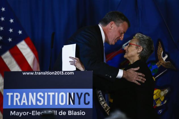 New York Mayor-elect De Blasio congratulates Barrios-Paoli during the announcement of her appointment as the new Deputy Mayor for Health and Human Services at a news conference in New York