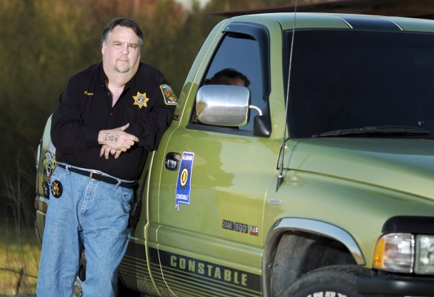 Jeffrey Nelson poses with his truck in rural Walker County in Alabama March 28, 2013. Nelson is the subject of subprime lending by a local autodealer. Picture taken March 28. To match Special Report USA-QE3/SUBPRIMEAUTO      REUTERS/Marvin Gentry (UNITED STATES - Tags: BUSINESS SOCIETY TRANSPORT)