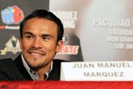 "Mexican boxer Juan Manuel Marquez smiles during a press conference in Califorrnia on September 17. ""I beat him the first three fights but did not get the decision; this time I will beat him again and I also will get the victory officially,"" Marquez said"