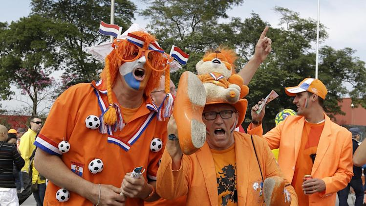 Dutch fans cheer for their national team before the group B World Cup soccer match between the Netherlands and Chile at the Itaquerao Stadium in Sao Paulo, Brazil, Monday, June 23, 2014. (AP Photo/Thanassis Stavrakis)