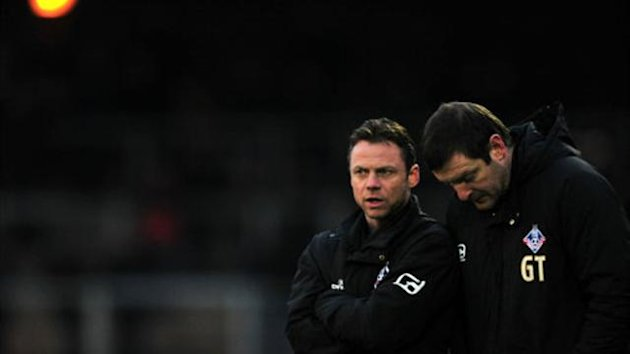 Paul Dickov, left, will remain at Oldham but Gerry Taggart, right, and two other members of the backroom staff have been put on gardening leave