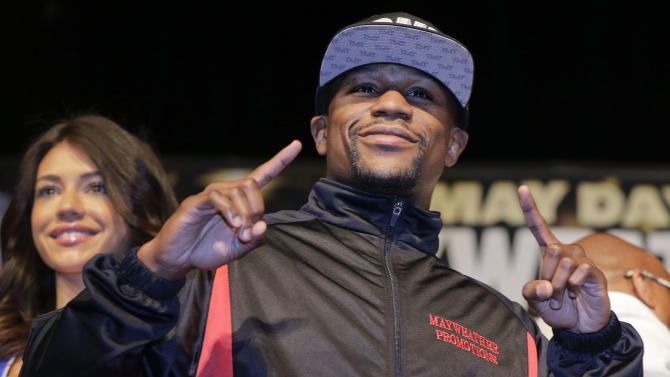 Floyd Mayweather Jr. poses for photos at the end of a news conference, Wednesday, May 1, 2013, in Las Vegas. Mayweather faces Robert Guerrero on Saturday for Mayweather's WBC welterweight title. (AP Photo/Julie Jacobson)