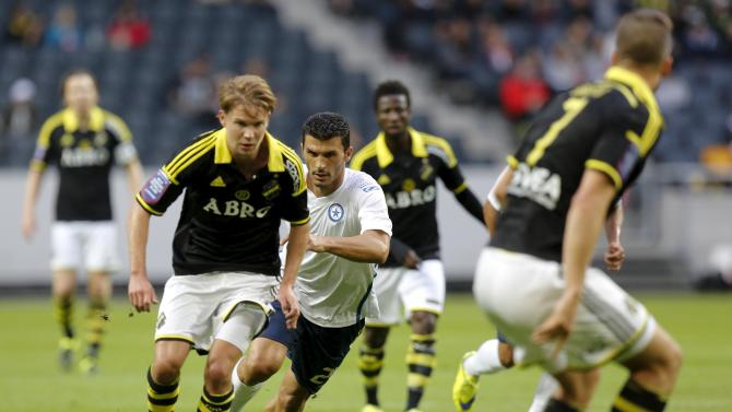 AIK's Johan Blomberg (L) is challenged by Atromitos' Nikos Lazaridis during the UEFA Europa League third qualifying round first leg match between Swedish AIK and Greek Atromitos FC at Friends Arena in Stockholm, Sweden